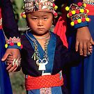 White Hmong girl in her finery by John Spies