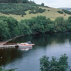 Our boat moored at Pier of Urquhart Castle Urquhart Bay Loch Ness Scotland 19840910 0005  by Fred Mitchell