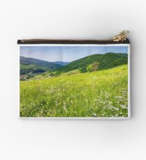 grassy meadow on a hillside Studio Pouch