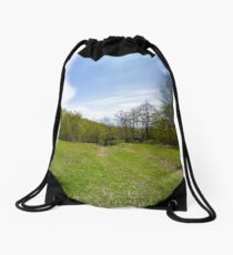 log on the grassy meadow among the forest Drawstring Bag
