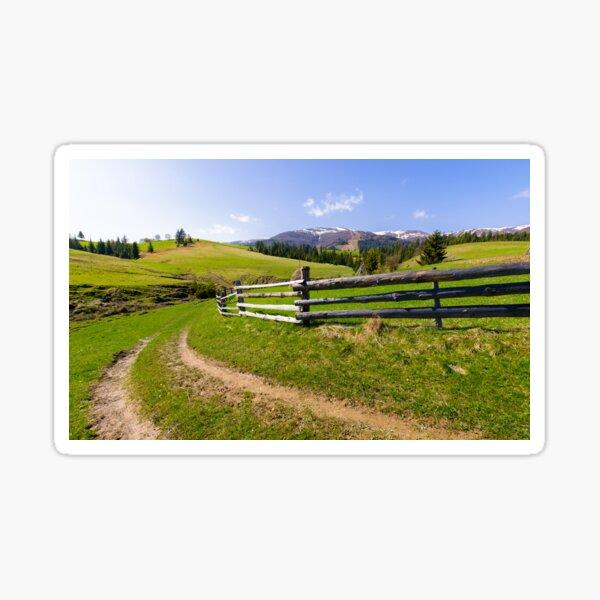 country road through grassy rural hillside Sticker