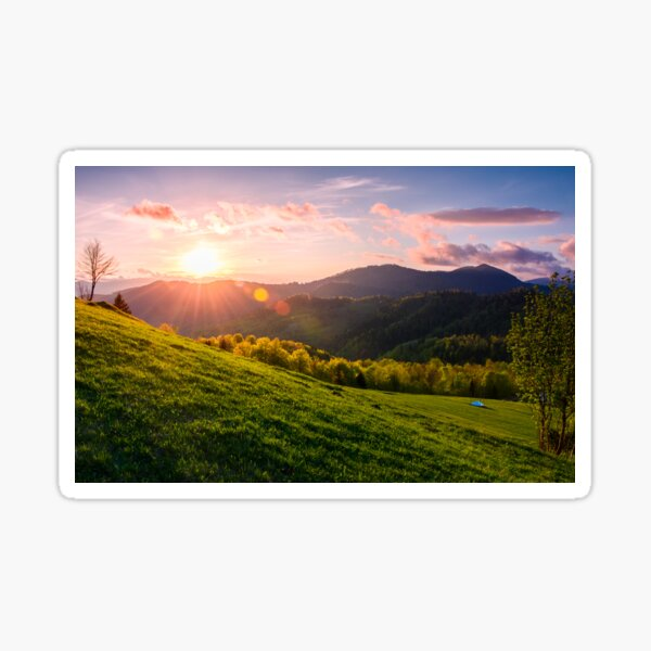 pink sunset over the mountains in springtime Sticker