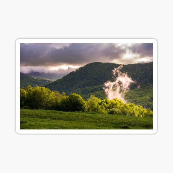 fog rising above the forest on hillside Sticker