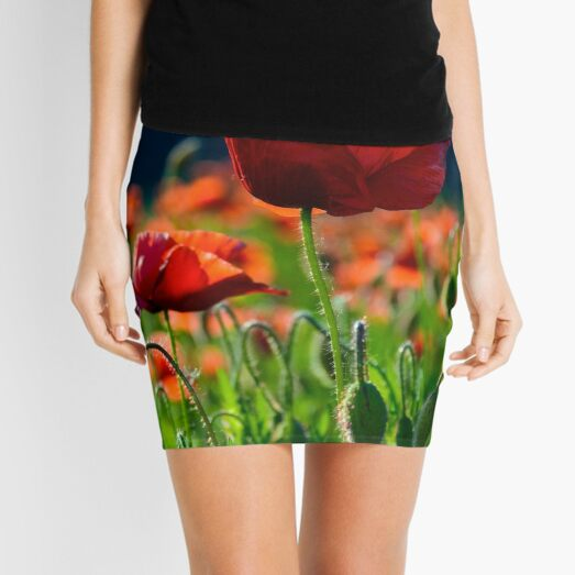 big red blossoming poppy flower in the field Mini Skirt