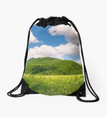 haystack on the grassy field in mountains Drawstring Bag
