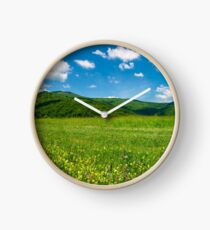 beautiful landscape with meadow in mountains Clock