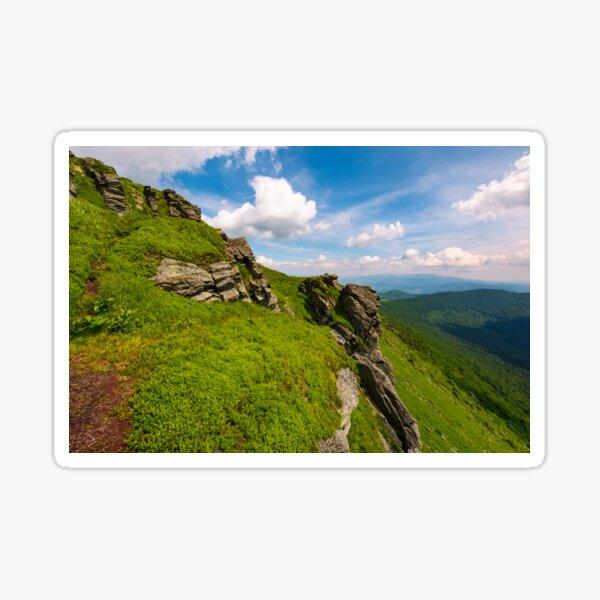 grassy hillside with boulders Sticker