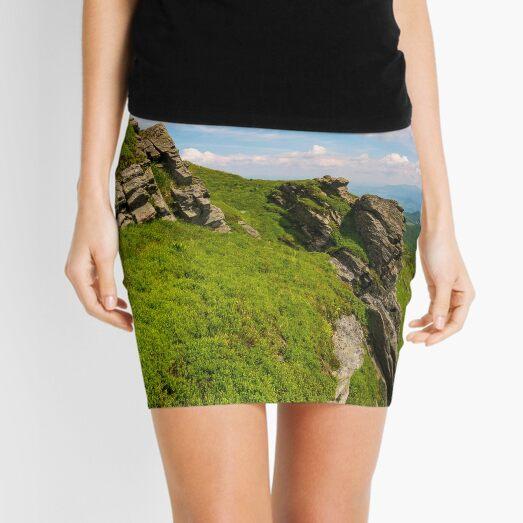 grassy hillside with boulders Mini Skirt