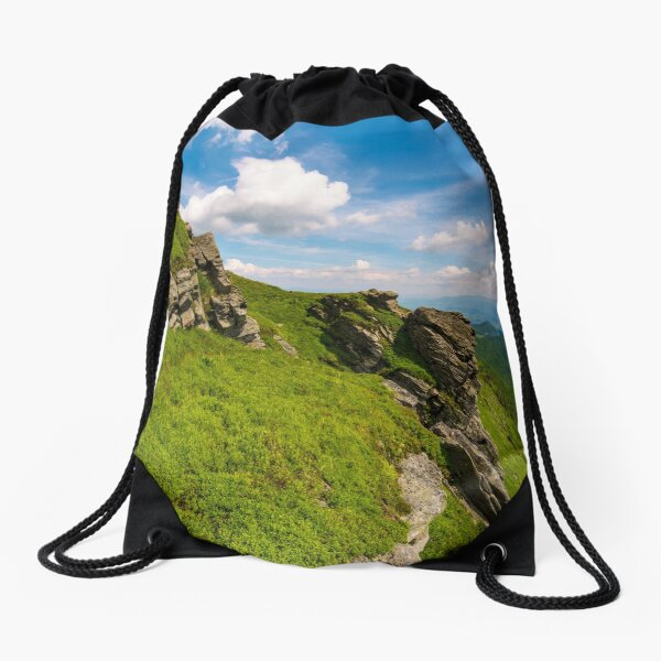 grassy hillside with boulders Drawstring Bag