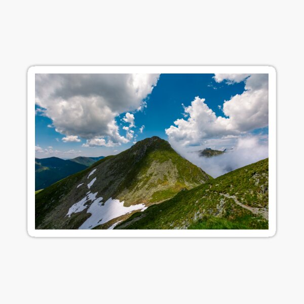Peaks of mountain ridge among the clouds Sticker