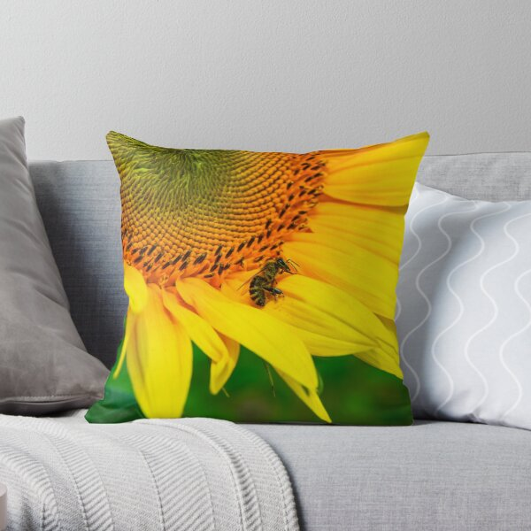 bees gathering pollen of the sunflower Throw Pillow