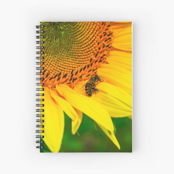 bees gathering pollen of the sunflower Spiral Notebook
