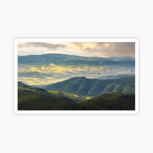 sun lit valley in afternoon Sticker