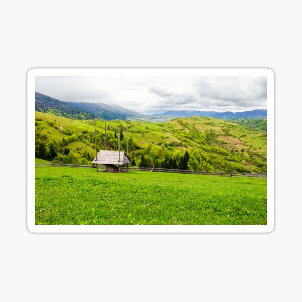 woodshed on grassy hill in rural area Sticker