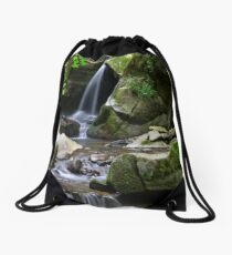 small waterfall among the rocks Drawstring Bag