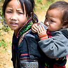 Vietnamese Hill-tribe girl and her baby brother by Kerry Dunstone