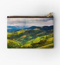 springtime in mountainous countryside Studio Pouch