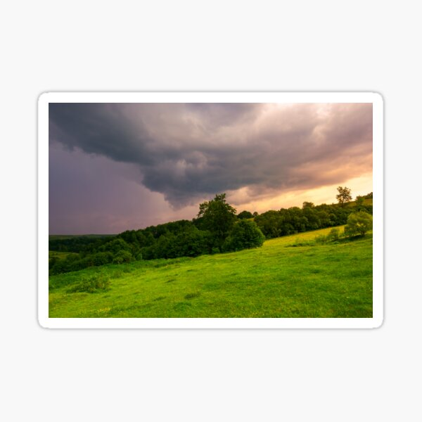 beautiful countryside on a cloudy sunset Sticker