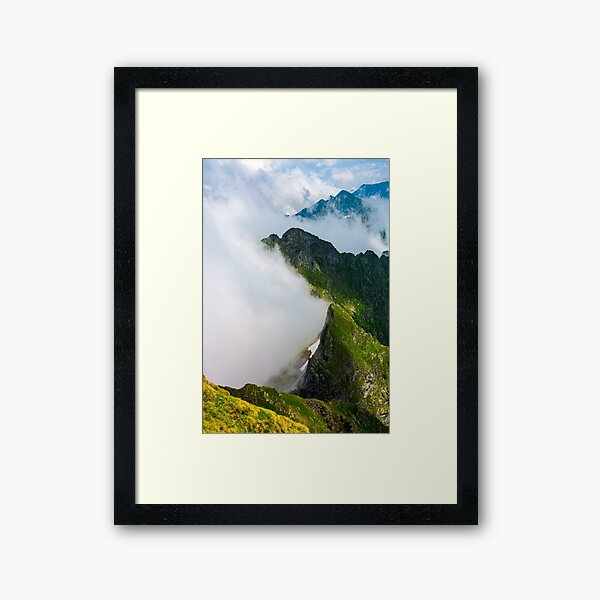clouds rising in Fagaras mountains Framed Art Print