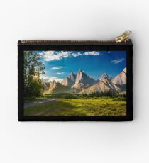 composite landscape with rocky peaks at sunset Studio Pouch