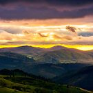 mountain rural area in springtime at cloudy sunset by mike-pellinni