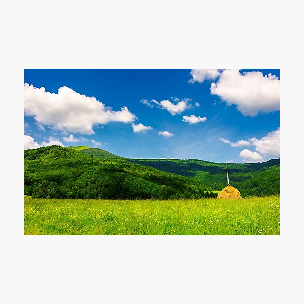 haystack on a grassy pasture in mountains Photographic Print
