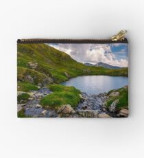rapid streams flow to lake Capra in mountains Studio Pouch