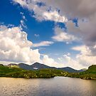 gorgeous cloudscape over the Capra lake by mike-pellinni