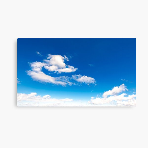 amazing cloud formations on a blue sky Canvas Print