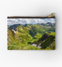 valley with snow in summer mountains Studio Pouch