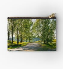 trees by the serpentine road in mountains Studio Pouch