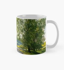trees by the serpentine road in mountains Mug