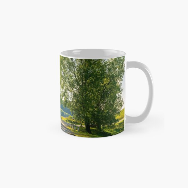 trees by the serpentine road in mountains Classic Mug