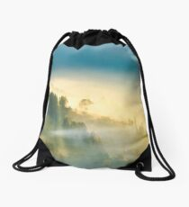 trees in glowing morning fog Drawstring Bag