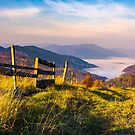 beautiful mountainous landscape with wooden fence by mike-pellinni