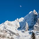 Alpine moon high above the mountains of Chamonix in the French Alps by Chris Warham