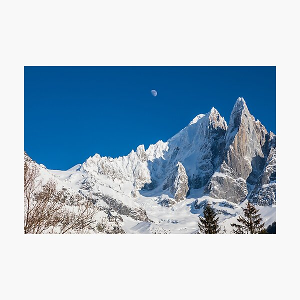 Alpine moon high above the mountains of Chamonix in the French Alps Photographic Print