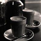 latte's at bekendales ( by the window - b&w film) by deborah brandon
