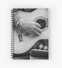 Street guitarist plays classical guitar black and white photo Spiral Notebook
