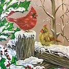 Christmas Cardinals in snow by Michael Arnold