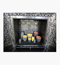 Colourful Ceramics in Fireplace Photographic Print