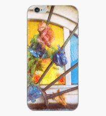 Fake flowers against multicolored glass iPhone Case