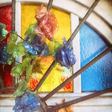 Fake flowers against multicolored glass by sil63