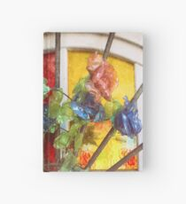 Fake flowers against multicolored glass Hardcover Journal