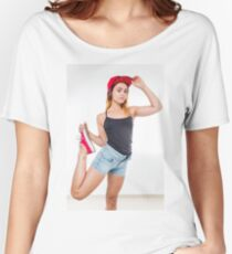 Flexible female teen with red baseball cap wearing black top  Women's Relaxed Fit T-Shirt