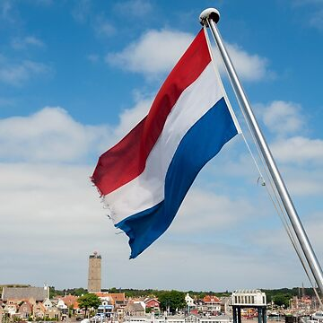 West Terschelling Friesland The Netherlands View of the town with the Dutch flag waving from a stern of a ship. by stuwdamdorp