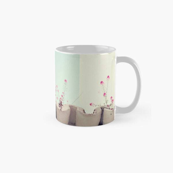 Pink flowers on the white rooftop Classic Mug