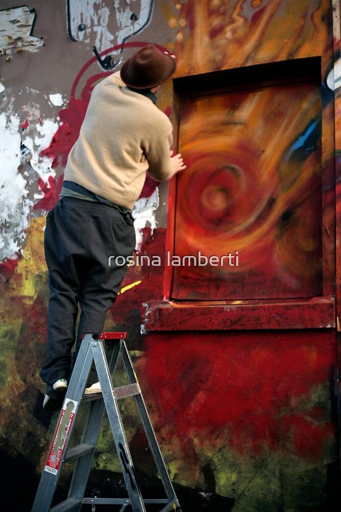 Graffiti artists at work by Rosina  Lamberti