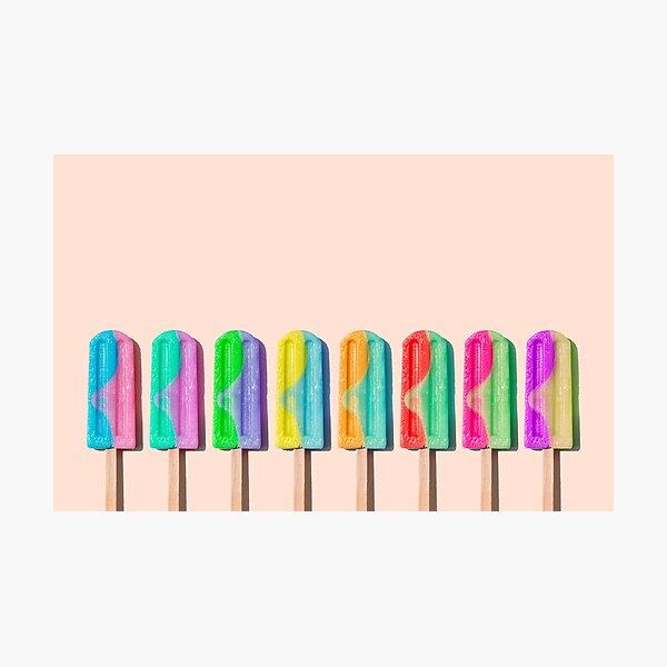 Row of rainbow-colored icecream lollies Photographic Print