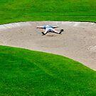 Golfer in Bunker by Mats Silvan